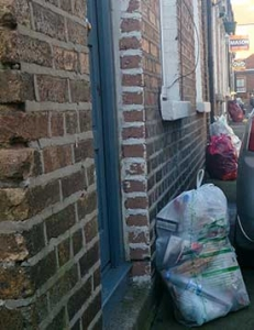 picture of bags of rubbish being left outside households front doors.