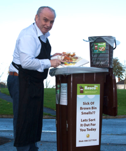 Picture of food waste being deposited into a Brown bin.